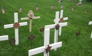 crosses at cemetery on Memorial Day