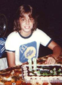 Me at 11. Note McD's t-shirt (Also check out the nifty satin jacket behind me.)